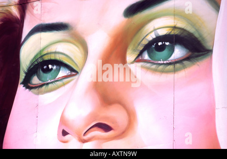 India Old Delhi gigantic cinema posters detail womans green eyes - Stock Photo