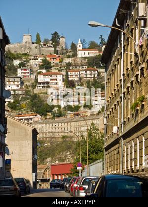 Rijeka Croatia, street 'Vodovodna ulica' and Trsat fort on top of hill in background - Stock Photo