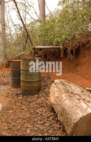 Old Moonshine Still Barrel at Hagood Grist Mill Pickens South Carolina USA - Stock Photo