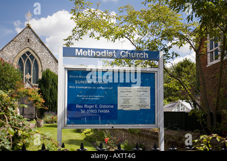 Notice about church services in front of Methodist church in Steyning, West Sussex, England, UK - Stock Photo