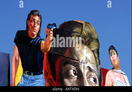 India Old Delhi gigantic cinema posters on Nataji Subhash detail man with gun - Stock Photo