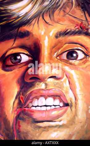India Old Delhi gigantic cinema posters detail face of man fighting - Stock Photo