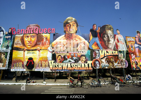 India Old Delhi cycle rickshaws beneath gigantic cinema posters on Nataji Subhash - Stock Photo