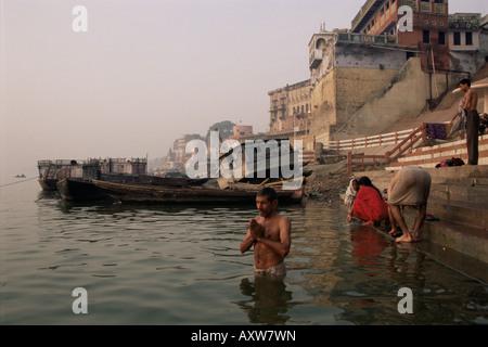 Morning ablutions, Hindu pilgrims bathing in the River Ganges (Ganga), Varanasi (Benares), Uttar Pradesh state, - Stock Photo