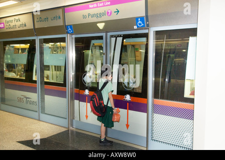 FARRER PARK station SINGAPORE asia MRT Mass Rapid Transit train system door girl is waiting for the train - Stock Photo