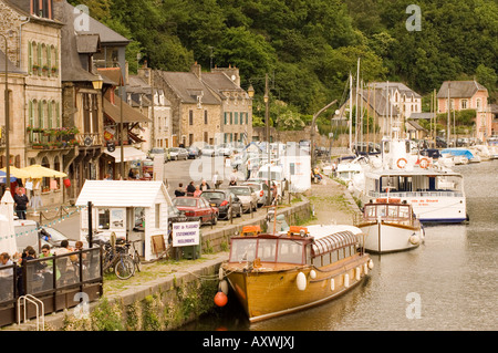 Boats on the River Rance and waterfront cafes in Port du Dinan, Brittany, France, Europe - Stock Photo