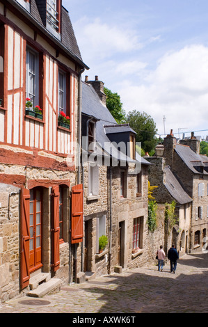 Old half timbered and stone buildings in the picturesque village of Dinan, Brittany, France, Europe - Stock Photo