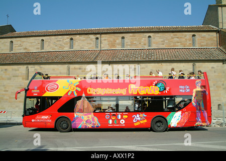 Tourists sightseeing from an  open top bus in Florence, Tuscany Italy - Stock Photo