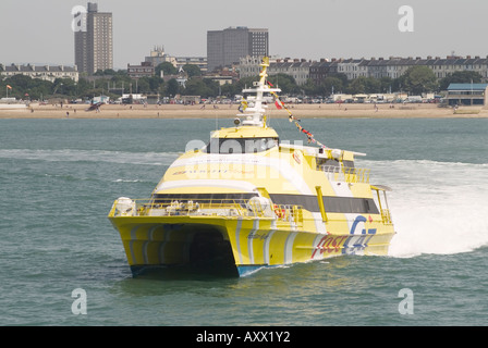 Wight link fast cat leaving Portsmouth for Ryde on the Isle of Wight - Stock Photo