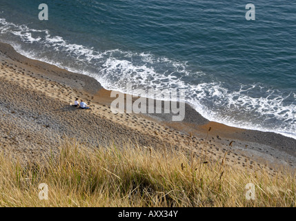 Couple on the Durdle Door Beach, Dorset, UK - Stock Photo