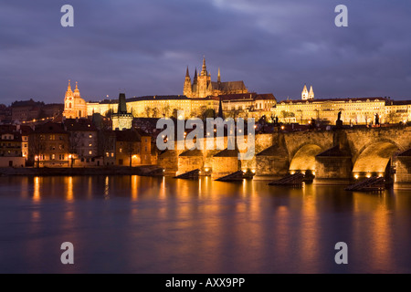 St. Vitus Cathedral, Charles Bridge and the Castle District illuminated at night in winter, Prague, Czech Republic - Stock Photo