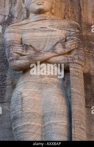 Rock carved granite image of the 7m tall standing Buddha, Gal Vihara, Polonnaruwa (Polonnaruva), Sri Lanka - Stock Photo
