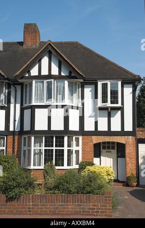 uk england surrey semi detached house in mock tudor style - Stock Photo
