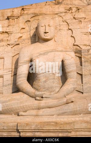 Rock carved granite image of the seated Buddha, Gal Vihara, Polonnaruwa (Polonnaruva), UNESCO World Heritage Site, - Stock Photo