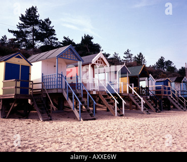 Row of beach huts along the beach promenade at Wells Next the Sea, Norfolk, UK - Stock Photo