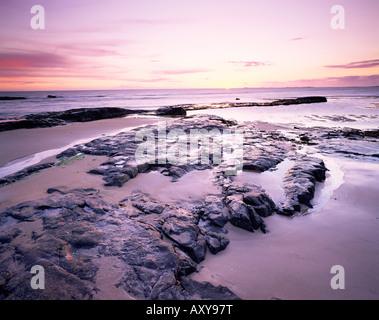 Sunrise over North Sea from Bamburgh beach, Bamburgh, Northumberland, England, United Kingdom, Europe - Stock Photo