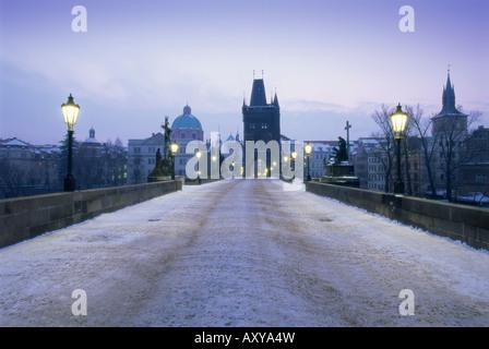 Charles Bridge in winter snow, Prague, UNESCO World Heritage Site, Czech Republic, Europe - Stock Photo