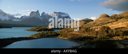 Cuernos del Paine rising up above Lago Pehoe, Torres del Paine National Park, Patagonia, Chile, South America - Stock Photo