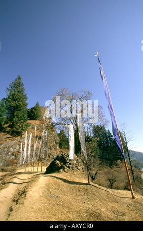 Bhutan Drukgyel Upper  prayer flags on path to Dzong - Stock Photo