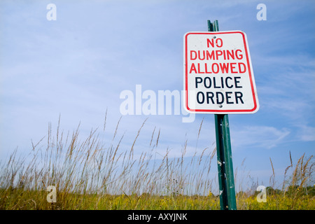 No Dumping Allowed Police Order Sign in prairie grasses - Stock Photo