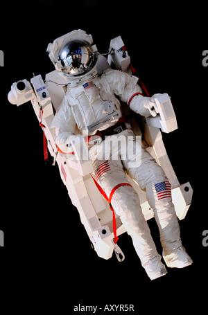Simulated Astronaut in Space model at the Cite des Sciences et de l'Industrie at La Villette Park in Paris, France - Stock Photo