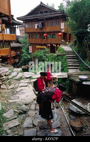 Aug 27, 2006 - Local women refresh themselves in the Yao minority village of Ping'an in China's Guangxi province. - Stock Photo