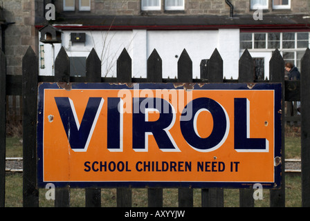 An old advert for 'Virol' on the station platform at Boat of Garten, Highland (editorial only). - Stock Photo