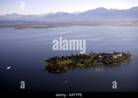 Frauenchiemsee, island in the Chiemsee, with the monastery Frauenwoerth, the Alps in the background, Germany, Bavaria, - Stock Photo