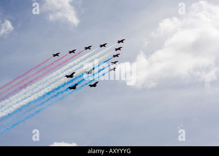 RAF Red Arrows formation aerobatic team flying in formation with 4 Typhoon aircraft over London to celebrate 90th - Stock Photo