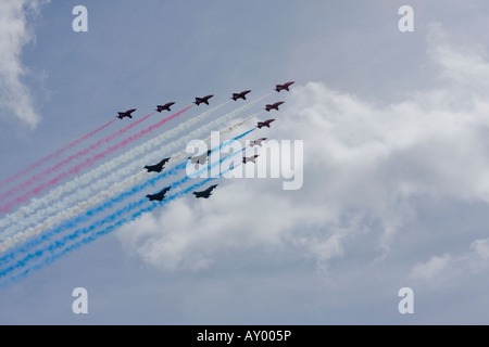 RAF Red Arrows formation aerobatic team flying in formation with four Typhoon aircraft over London to celebrate - Stock Photo