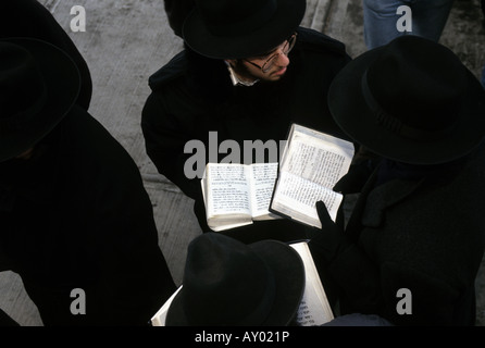 Rabbinical Students pray outside Lubavitcher World Headquarters in Crown Heights, Brooklyn. - Stock Photo