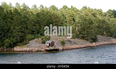A small shack near the water's edge - Stock Photo