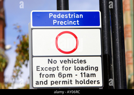 Pedestrian precinct no vehicles except for loading and permit holders sign in Belfast City Centre - Stock Photo