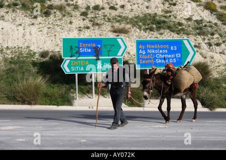 farmer with donkey on road near the city Sitia, Eastern Crete, Greece, Europe. Photo by Willy Matheisl - Stock Photo