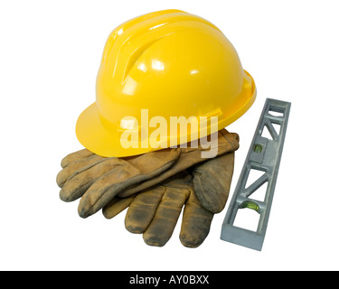Yellow hardhat, old leather gloves and a level isolated on white background - Stock Photo