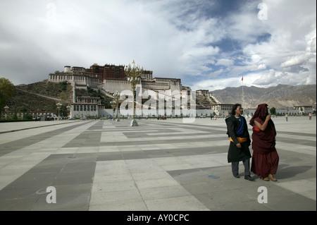 Monks in People's Park outside Potala Palace, Lhasa, Tibet Autonomous Region, China. Sept 06. - Stock Photo