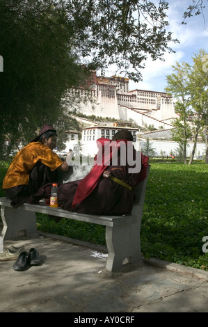 Young monks talk in People's Park in front of Potala Palace, Lhasa, Tibet, China. Sept 06. - Stock Photo