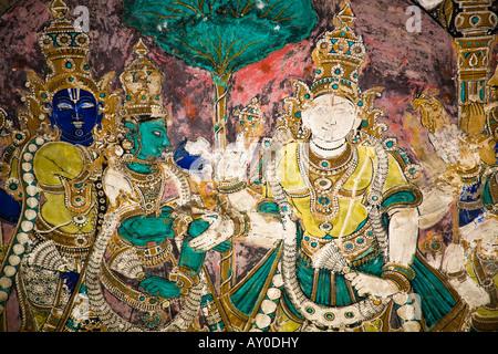 Colourful painting on a wall, Meenakshi Temple, Madurai, Tamil Nadu, India - Stock Photo