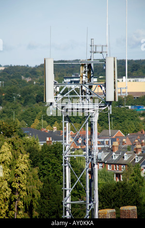 Mobile Phone Mast in close proximity to residential housing - Stock Photo