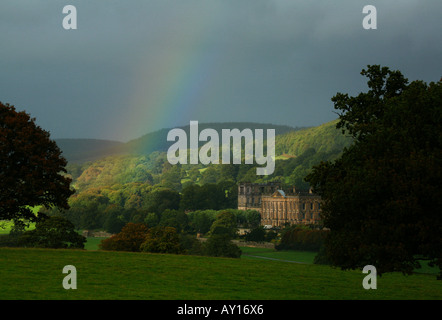 Rainbow and rain clouds over Chatsworth House in Derbyshire - Stock Photo