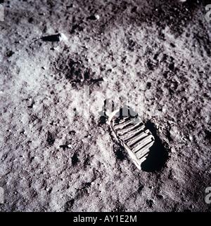 NASA Apollo 11 astronaut Neil Armstrong foot print on moon - Stock Photo