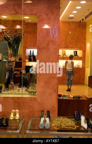 Shoe shop in Deira city centre shopping mall Dubai United Arab Emirates - Stock Photo