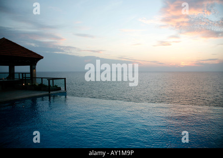 Swimming pool,sea and the sky at sunset time from Leela hotel,kovalam,kerala,india - Stock Photo