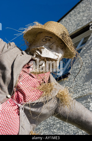 Urban Straw Scarecrow at the Scarecrow Festival, Hinderwell, Yorkshire Valley, North Yorkshire, Northern England, - Stock Photo