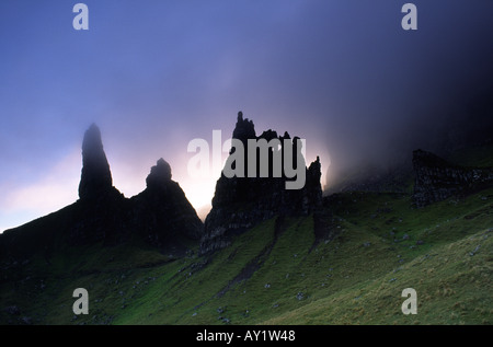 The Old Man of Storr being consumed by clouds at sunset on the Isle of Skye in Scotland UK - Stock Photo