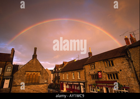 Rainbow at sunset over Half Moon Street in Sherborne town Dorset county England UK This photograph was taken in - Stock Photo