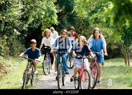 GROUP OF 8 CHILDREN AND TEENAGERS RIDING BIKES - Stock Photo