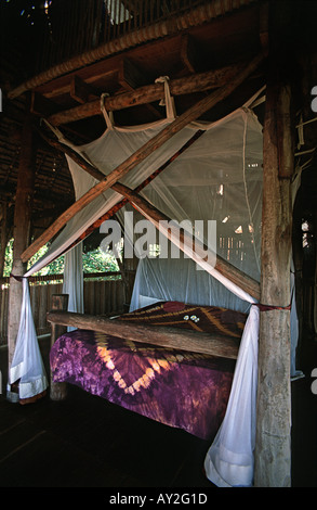 Tasteful but simple interior of one of the elevated luxury treehouses at Chole Mjini Lodge Chole Mafia island Tanzania - Stock Photo