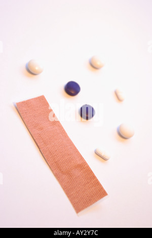 Fabric plaster and tablets - Stock Photo