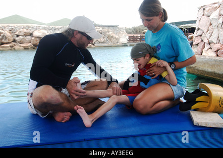Dolphin therapy Lucas Knecht who is mentally and fysically disabled is receiving treatment from therapist Marcus - Stock Photo